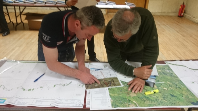 Checking the details of the EirGrid N/S Interconnector plan at the information meeting in Aughnamullen  Photo:  © Michael Fisher