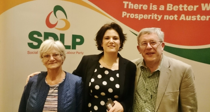 SDLP Councillor Claire Hanna (centre) with her parents Carmel and Eamon Hanna  Photo:  © Michael Fisher