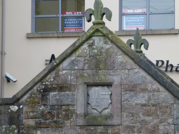 The Toll House, Carrickmacross: Fleur-de-Lys decoration and Shirley crest dated 1861  Photo:  © Michael Fisher