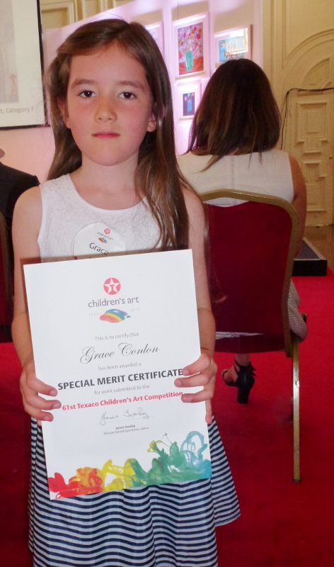 "Grace Conlon, Lannat,  Killanny, receives her special merit certificate for her painting ""Bird Tunes"".   Photo:  © Michael Fisher"