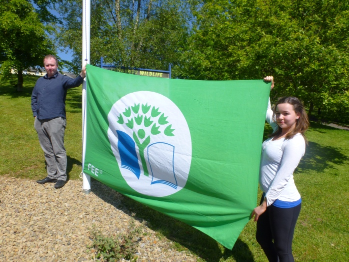 Past pupils Terry Cavanagh and Frances Treanor (Texaco Art Winner 2015) raising the second green flag at Tydavnet National School  Photo:  © Michael Fisher