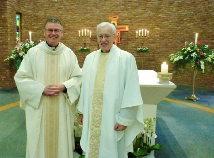 Fr Eddie O'Donnell, Parish Priest, St Brigid's Belfast and Canon Brian McCluskey (right) at the Mass marking his 55th anniversary as a priest. Photo:  © Michael Fisher