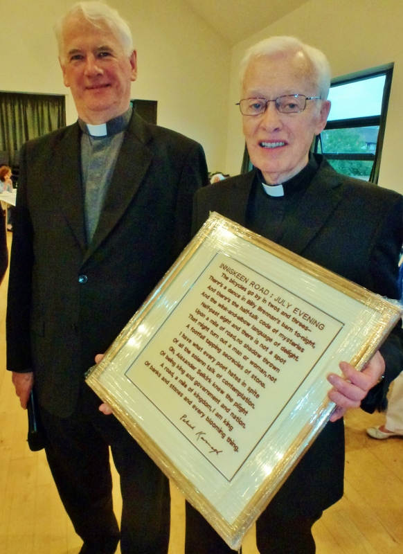 Bishop of Down and Connor, Dr Noel Treanor with Canon Brian McCluskey, who was presented with an embroidered copy of a Patrick Kavanagh poem about Inniskeen.  Photo:  © Michael Fisher