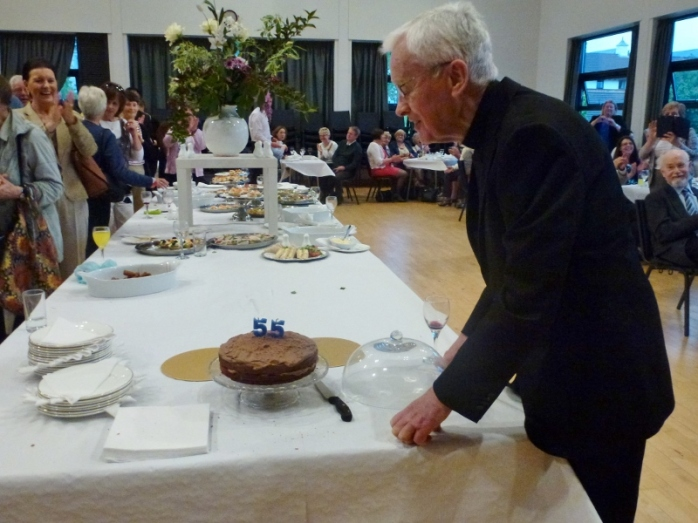 Blowing out the candles on the anniversary cake: Canon Brian McCluskey. Photo:  © Michael Fisher