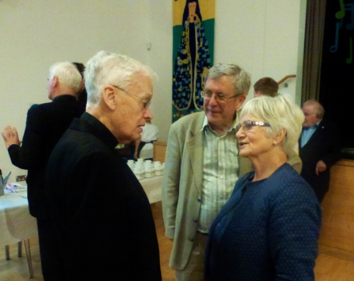 Canon Brian McCluskey with parishioners Eamon Hanna and his wife Carmel, former MLA for South Belfast. Photo:  © Michael Fisher