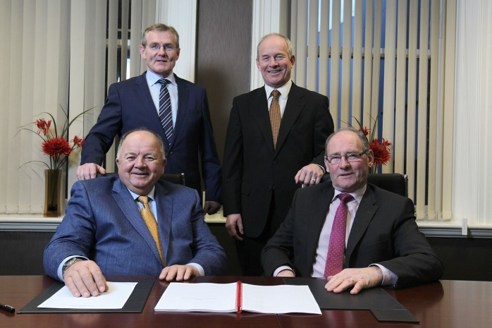Standing are Gabriel D'Arcy (Chief Executive of newly formed LacPatrick Co-op) and Nigel Kemps (Deputy Chief Executive LacPatrick Co-op), with (seated) Hugo Maguire (Chairman, LacPatrick Co-op) and Roy Irwin Deputy Chairman. Photo: © Brian Thompson Photography