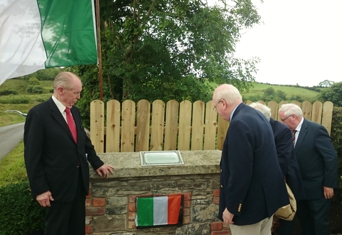 Michael McDowell SC is watched by Paddy Mac Carvill's son Niall (left) and Brendan Smith T.D. (right) as he unveils the plaque and memorial at Blackraw  Photo:  © Michael Fisher