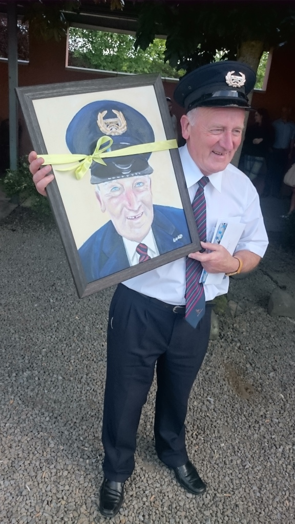 Paddy Gollogly with the portrait painted by one of the Dinkin's cafe staff, Goda Sirutyte  Photo:  © Michael Fisher