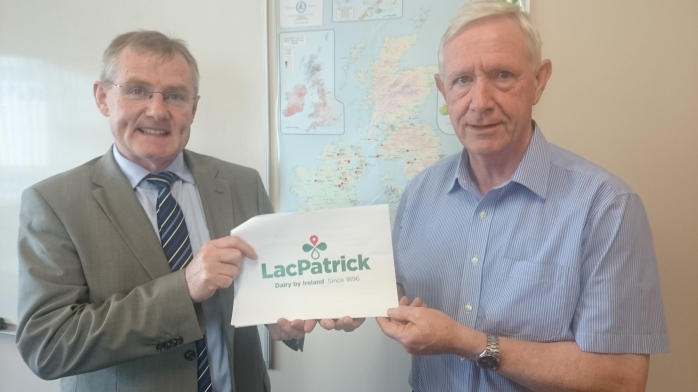 Gabriel D'Arcy, Chief Executive of newly formed LacPatrick Co-op and Aidan McCabe, Dairy Adviser, with the new Lacpatrick logo  Photo:  © Michael Fisher