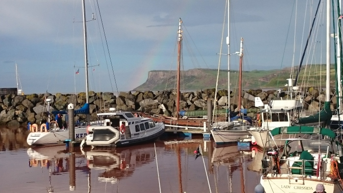 Ballycastle Harbour with Fair Head in background and Mac Duach in middle Photo:  © Michael Fisher