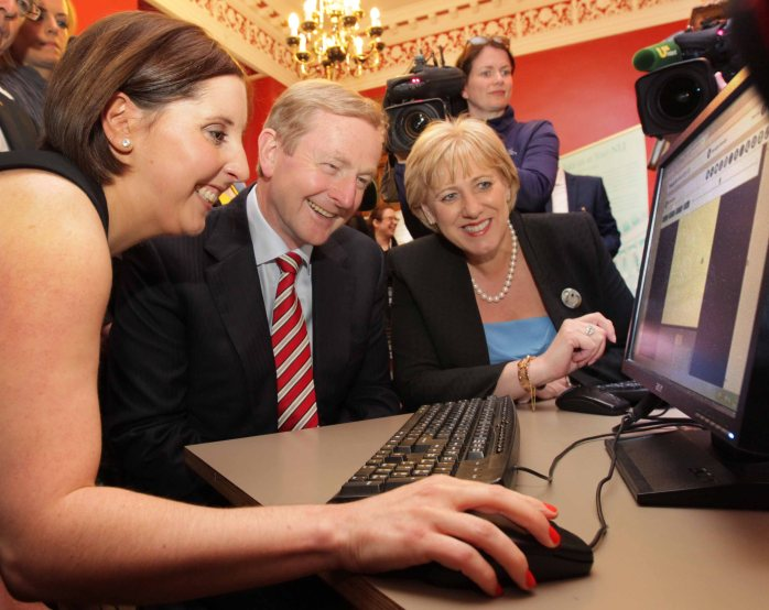 Pictured at the launch of the National Library of Ireland's new web-repository of parish records are Taoiseach, Enda Kenny T.D. and Minister for Arts, Heritage and the Gaeltacht, Heather Humphreys T.D., talking to Ciara Kerrigan, project manager of the digitisation of parish registers NLI. Photo Mark Stedman, Photocall Ireland