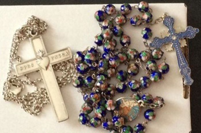 Sr Phil's RSCJ cross and rosary. recovered from the plane wreckage, were among the items stolen last month from her sister's home in Richmond, Victoria  Photo: Victoria Police